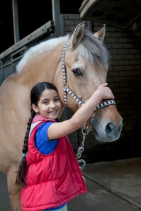 Little girl with her favorite horse